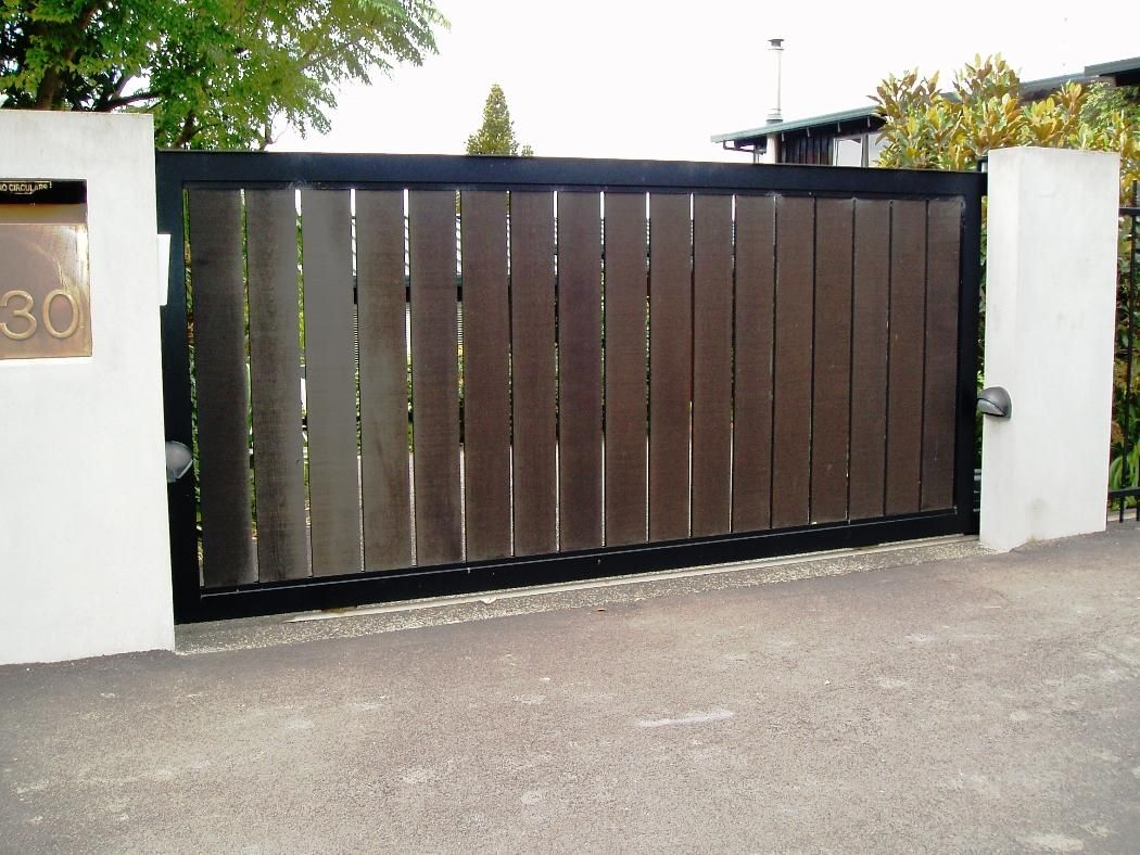 Single swing contemporary driveway gates all in one home for Wooden main gate design