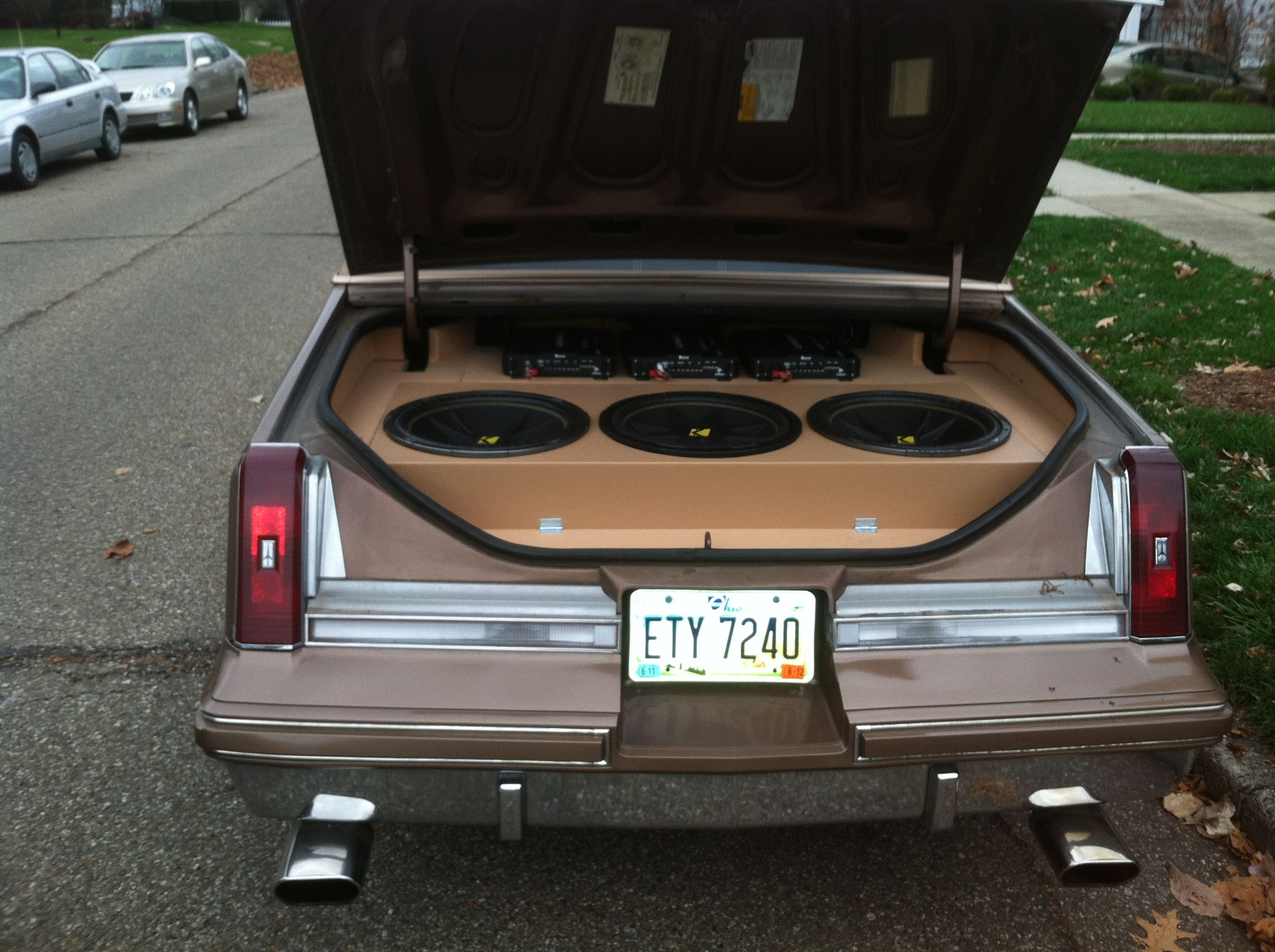 "Custom built box, 3 kicker competition speakers, an amp powering each speaker, in a 1985 Cutlass, was lifted 14 inches, and powder coated 28"" rims."