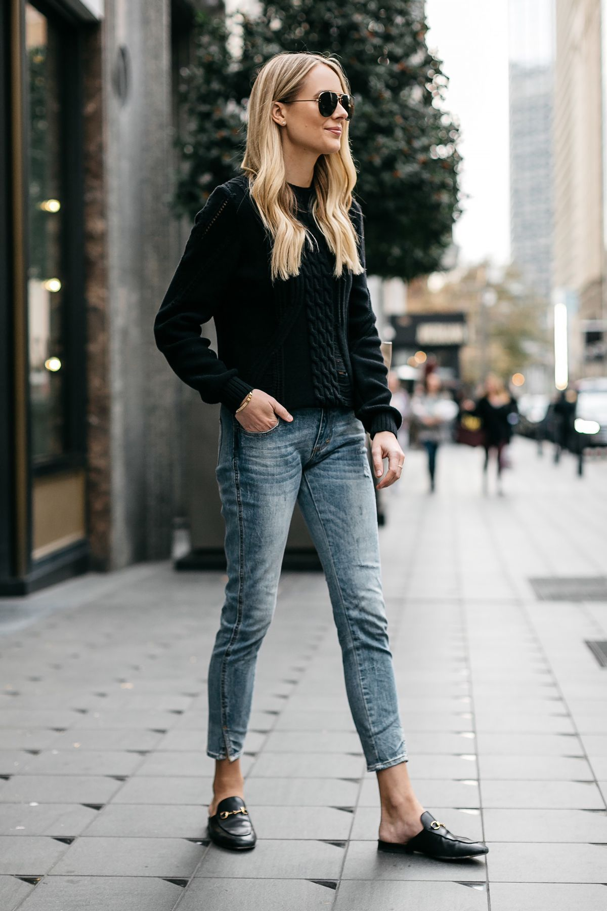 bc85530fb411 Blonde Woman Wearing Black Sweater Denim Jeans Outfit Frame Black Cable  Knit Sweater Denim Split Hem Skinny Jeans Gucci Loafer Mules Fashion  Jackson Dallas ...
