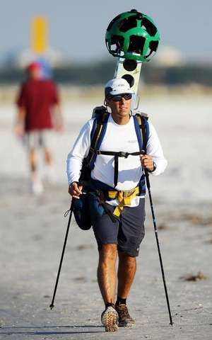 Google Maps team member David DeLong maps Fort Myers Beach on Sunday. DeLong is among four trekkers walking 825 miles of Florida beaches