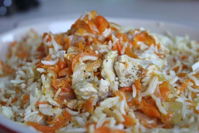 A one-pot, gluten-free recipe for Plov, a kosher Bukharan chicken and rice dish made with carrots and onions.