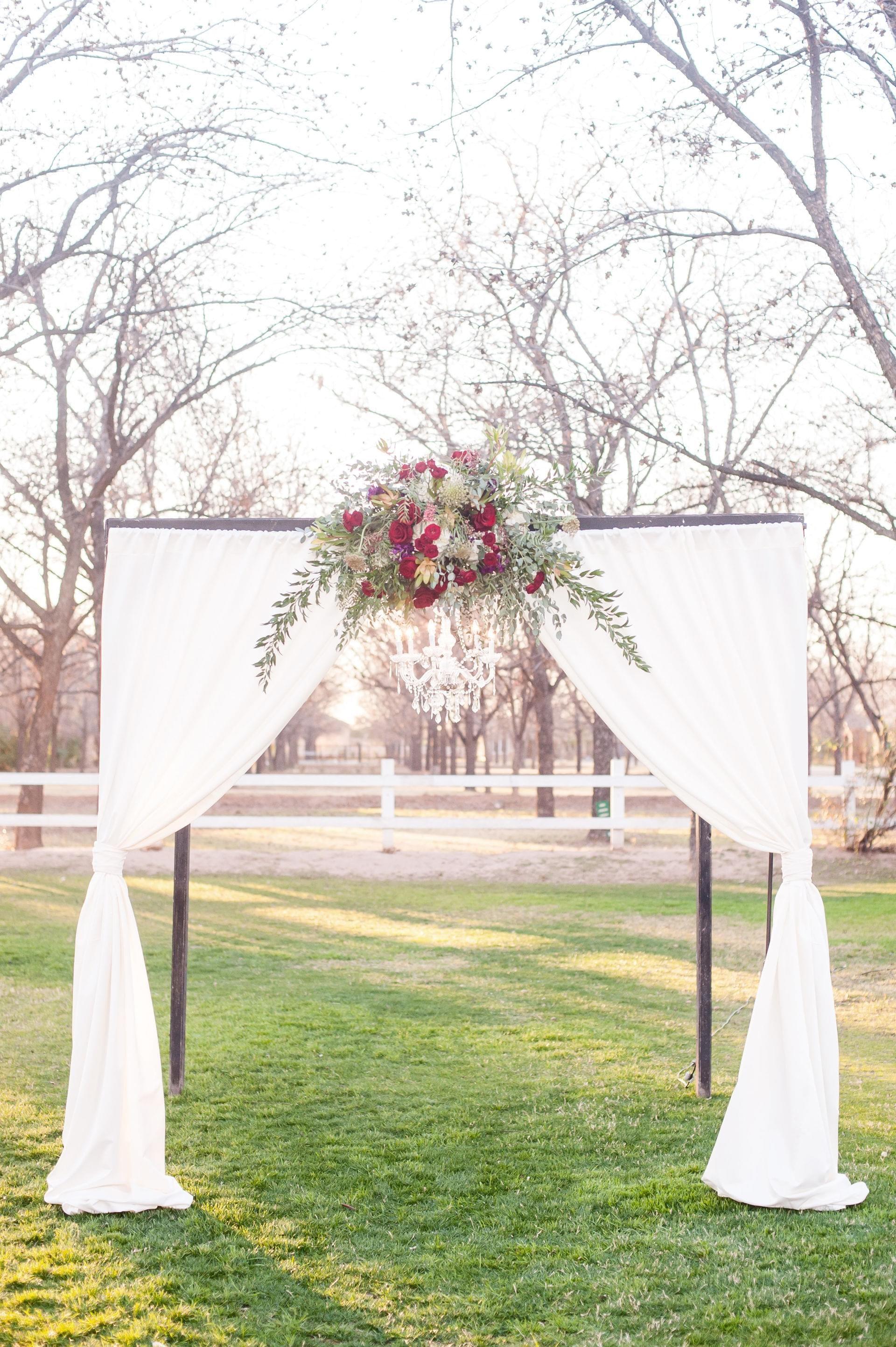 Romantic Outdoor Wedding Ceremony Arbor Ruby Red Flowers Draped