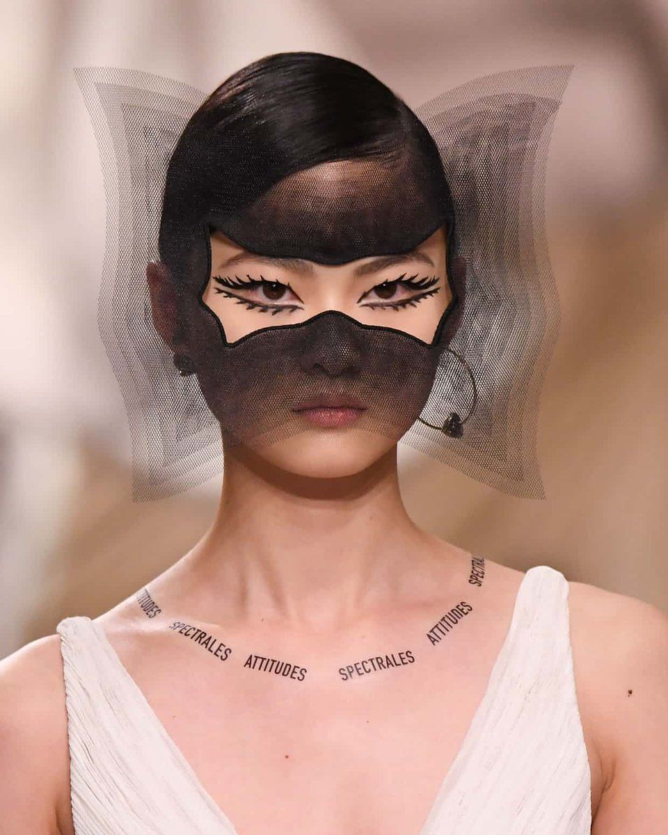 b5073e5cae ... Maria Grazia Chiuri showed off surrealist masks and temporary lettering  with political quotes for her spring-summer 2018 couture collection for Dior .