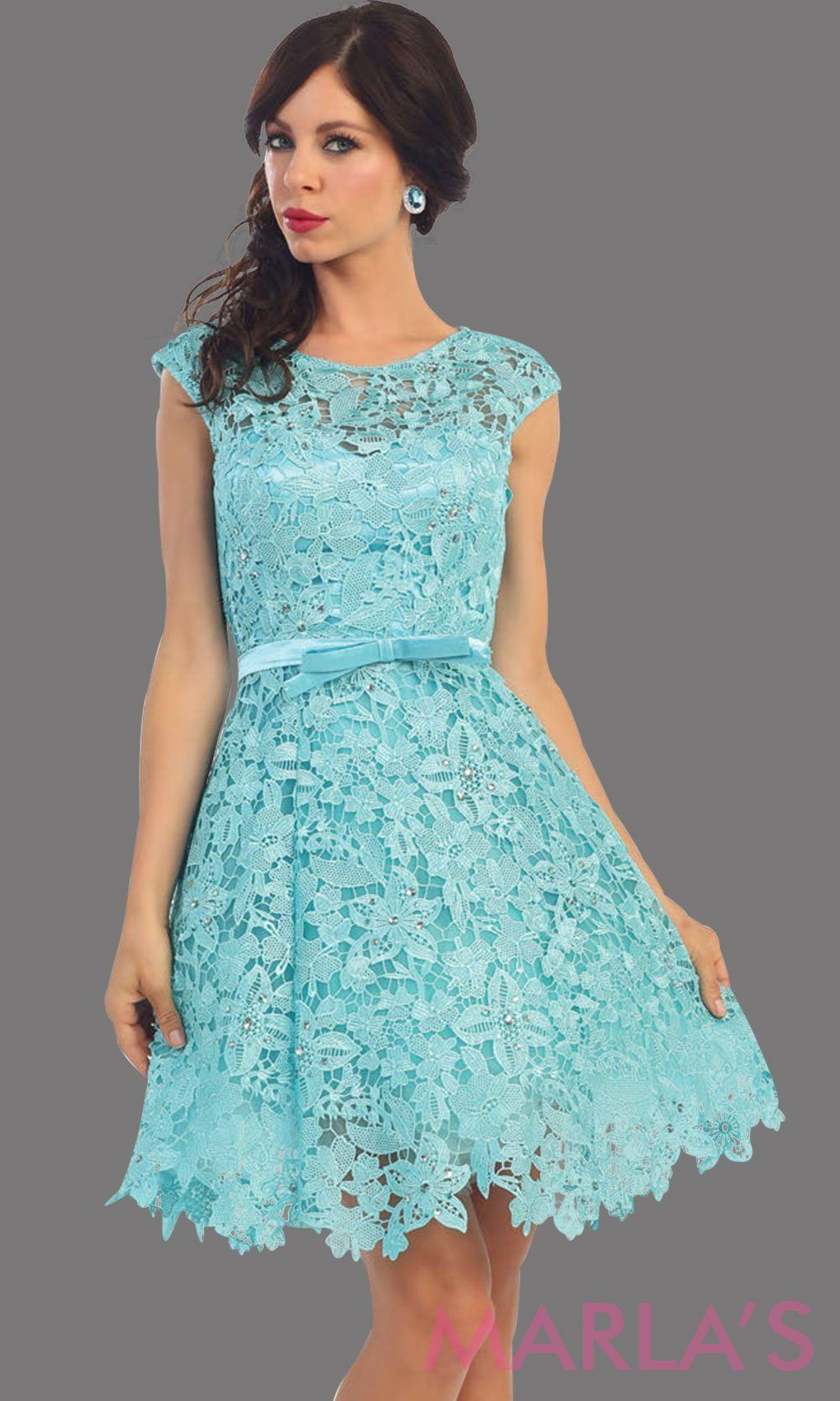 dace15f187b Short aqua lace high neck dress with a satin bow. This light blue dress has  a flowy skirt. It is perfect for grade 8 graduation dress