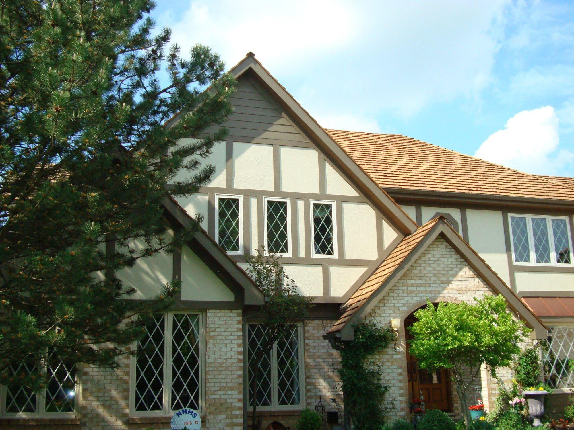A Classic Tudor Look With Hardiepanel And Hardietrim House Siding Tudor Style Homes Tudor Style