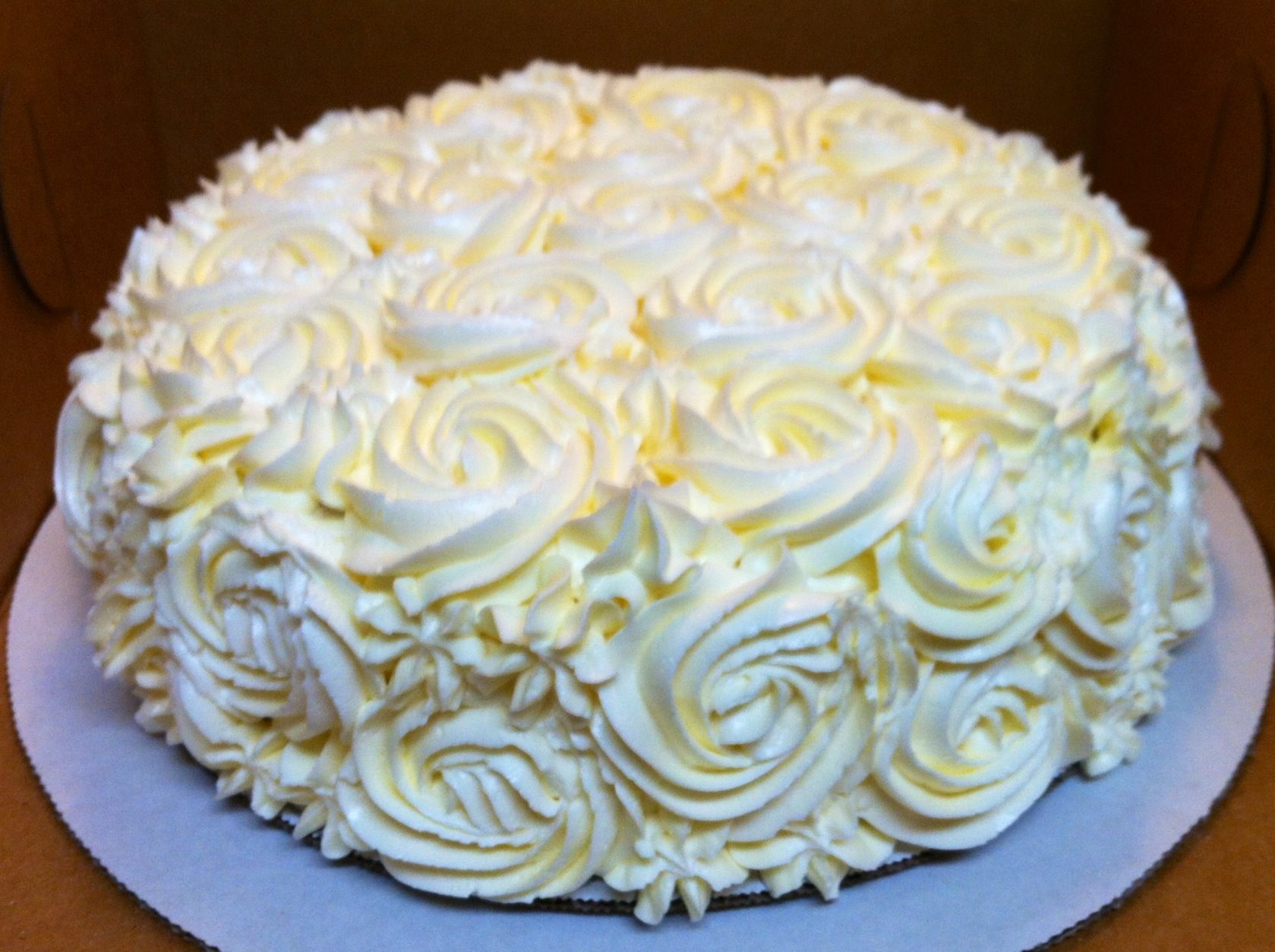 Top Of A Wedding Cake Coconut Chiffon With Italian Ercream Frosting Pipped As Rosettes