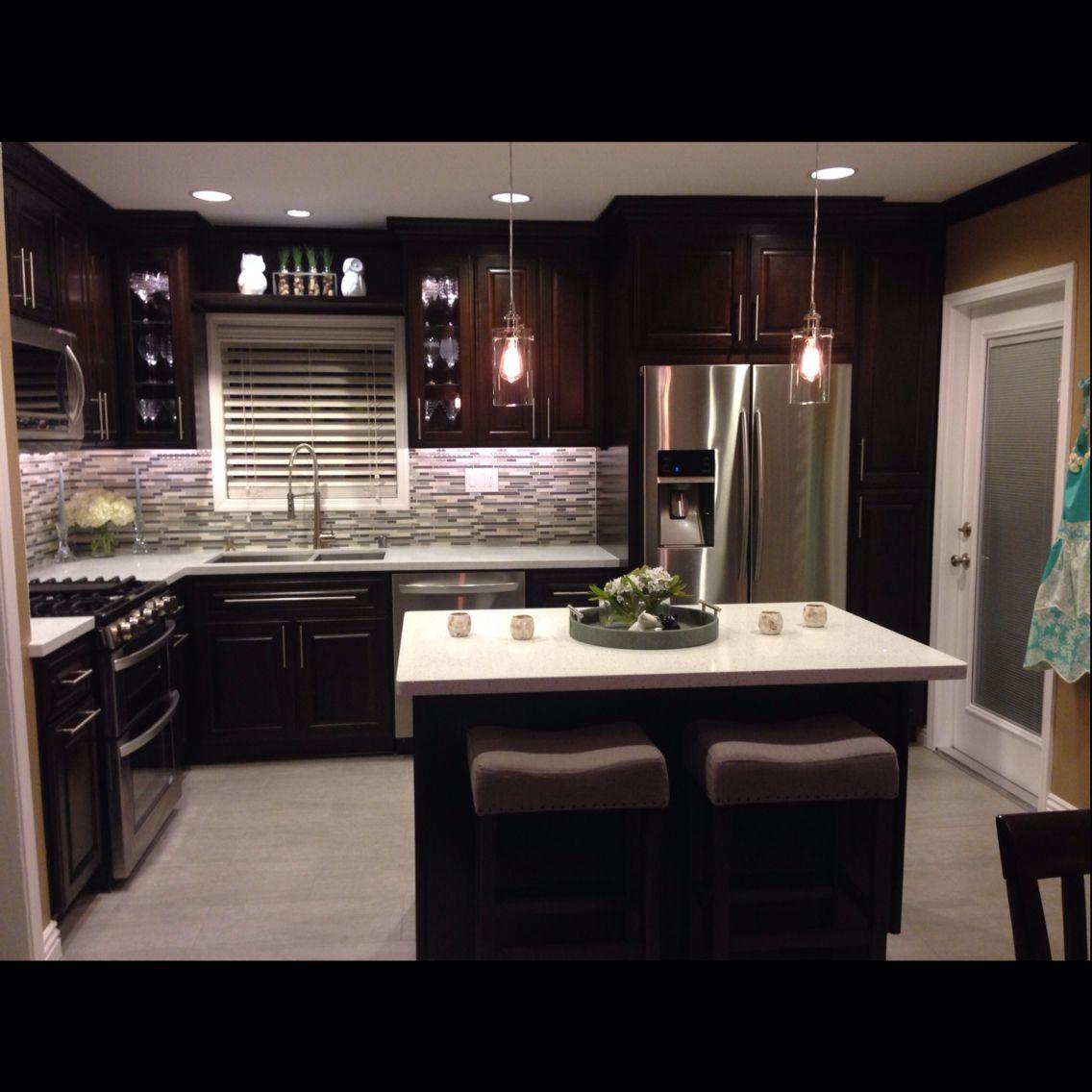 KitchenDark espresso cabinetsIced white quartz counter