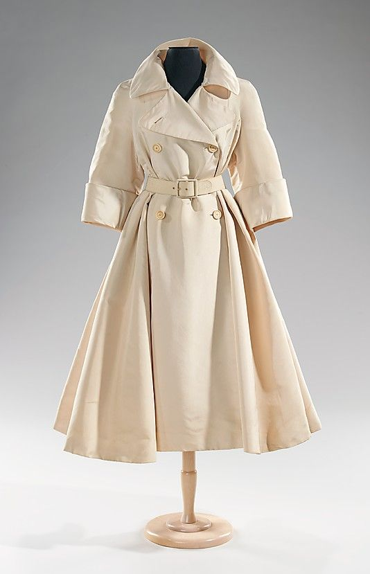 Coat (Trench Coat), Evening Traina-Norell (American, founded 1941) Designer: Norman Norell (American, Noblesville, Indiana 1900–1972 New York City) Date: ca. 1955 Culture: American Medium: silk--Norman Norell is credited as the father of American high fashion, an accolade well-deserved for a long career which established the country's fashion industry and made way for other great designers such as Bill Blass, James Galanos, and Halston.