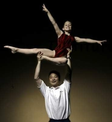 Future Olympian Shawn Johnson With Coach Liang At Chow S Gymnastics West Des Moines Iowa 2003 Shawn Johnson Gymnastics Pictures Gymnastics