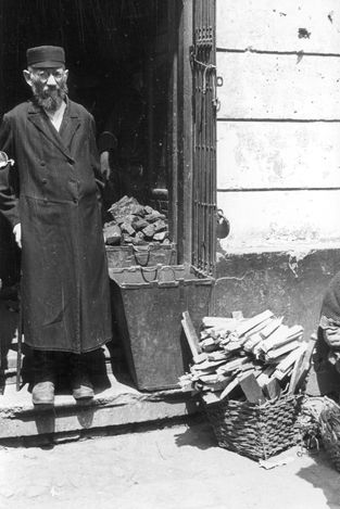 Warsaw, Poland, A Jew in front of a store. One of the photographs taken by the German photographer Willi George over the course of a single day in the summer of 1941. The photographs are unique in that they were not staged, but showed the ghetto as it truly was.