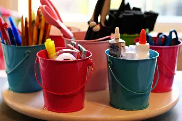Get some tin buckets from the Dollar Spot at Target and glue them down to a Lazy Susan.