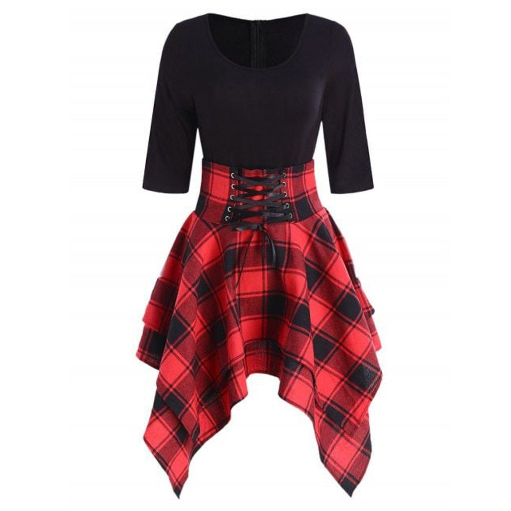 The Tartan Corset Dress A gorgeous and unique mid or long sleeved dress, with a plaid, asymmetrical hem line and a corseted waist band at the front! The top section of the dress, a flattering black body with a scooped neck, creates a super flattering silhouette to stun in.