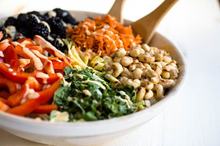 An easy recipe for a delicious, nutritious & vegan Thai Curry Salad that will leave you feeling full & satisfied. Full of nutrients & healthy fats, too!