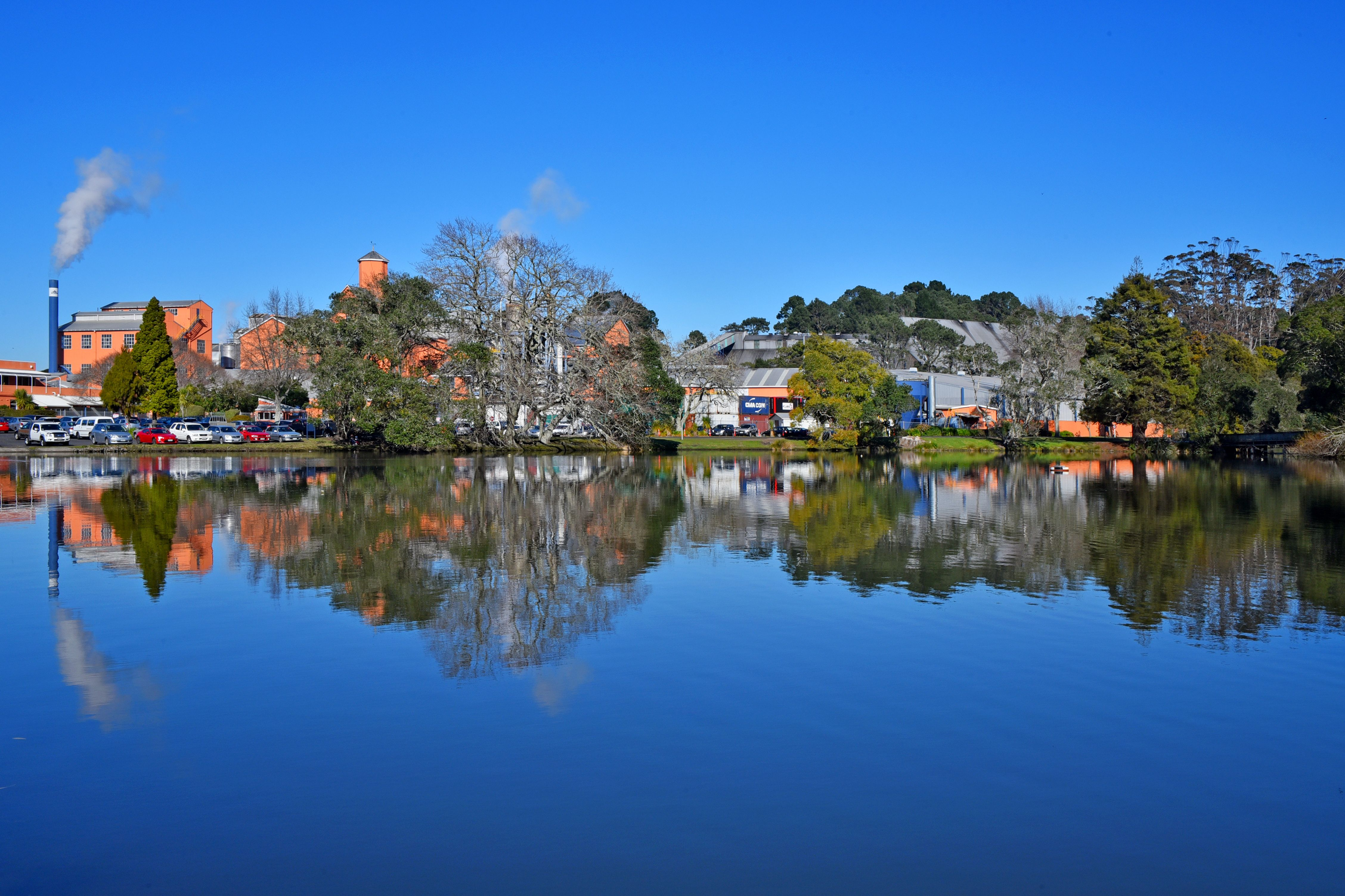 View of the sugar works over duck pond. Blue day on