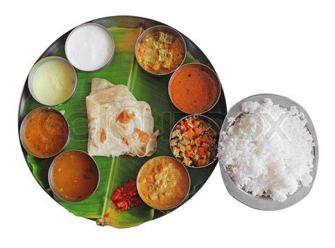 South Indian Plate Meals On Banana Leaf Isolated On White
