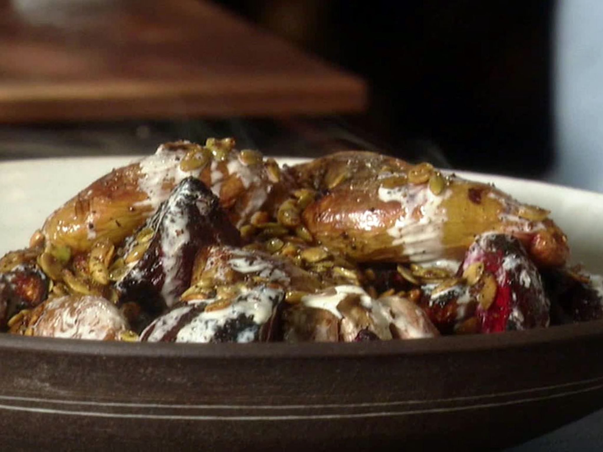 Roasted Root Vegetables with Spicy Pepitas and Horseradish Creme Fraiche recipe from Guy Fieri via Food Network