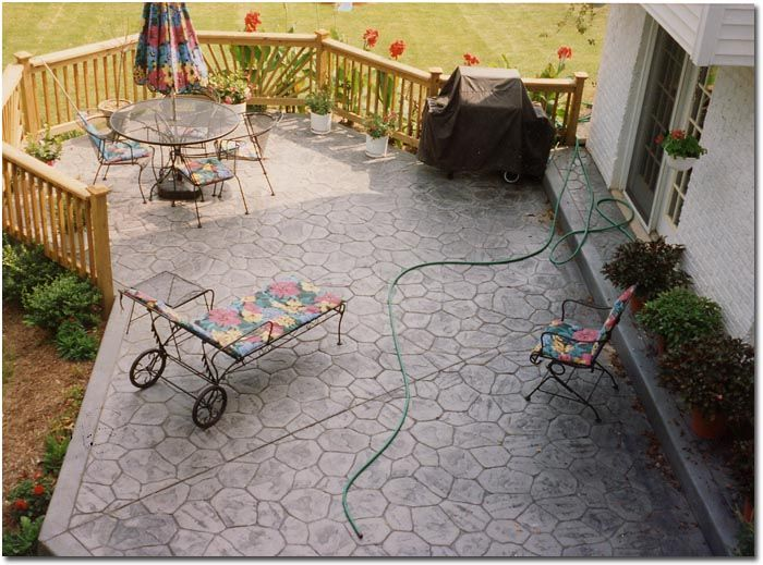 Concrete stamped patio with wooden fence | Stamped ...
