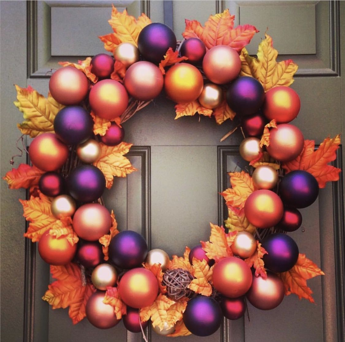 Autumn wreath made with glass balls and leaves on a grapevine wreath.