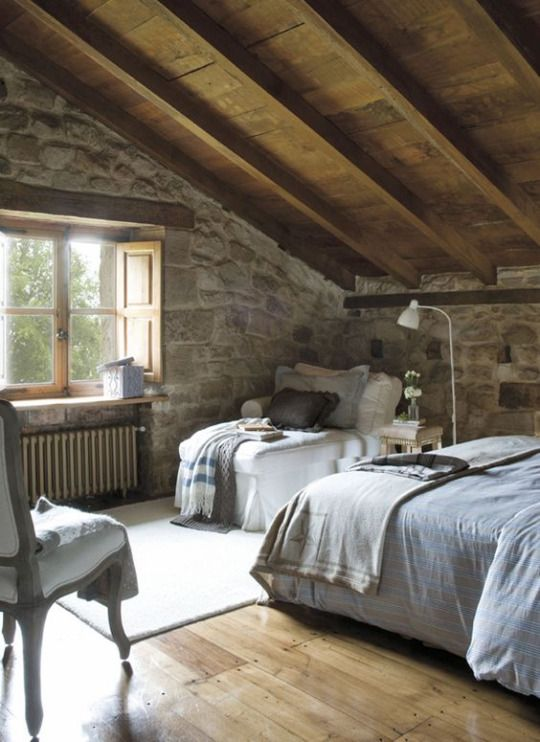 looks like an attic room in a cabin the grey color scheme with the vaulted wood ceiling and stone walls is perfect - Stone Cottage Interiors
