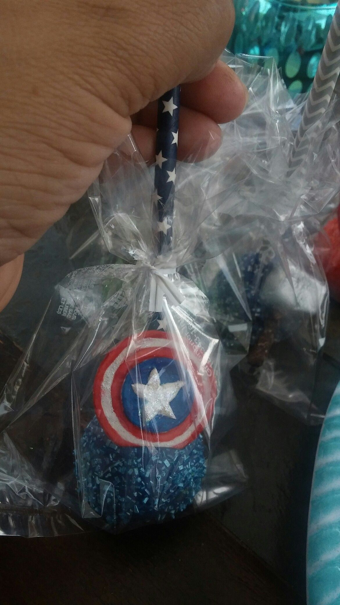 Captain america cake pop created by majestic delicasys