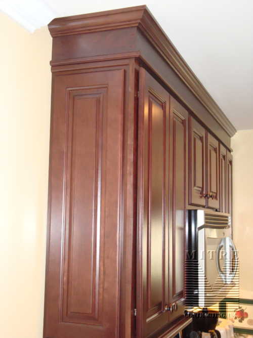 kitchen cabinets close up of crown moulding build up and raised end panels - Kitchen Cabinet Trim Molding Ideas
