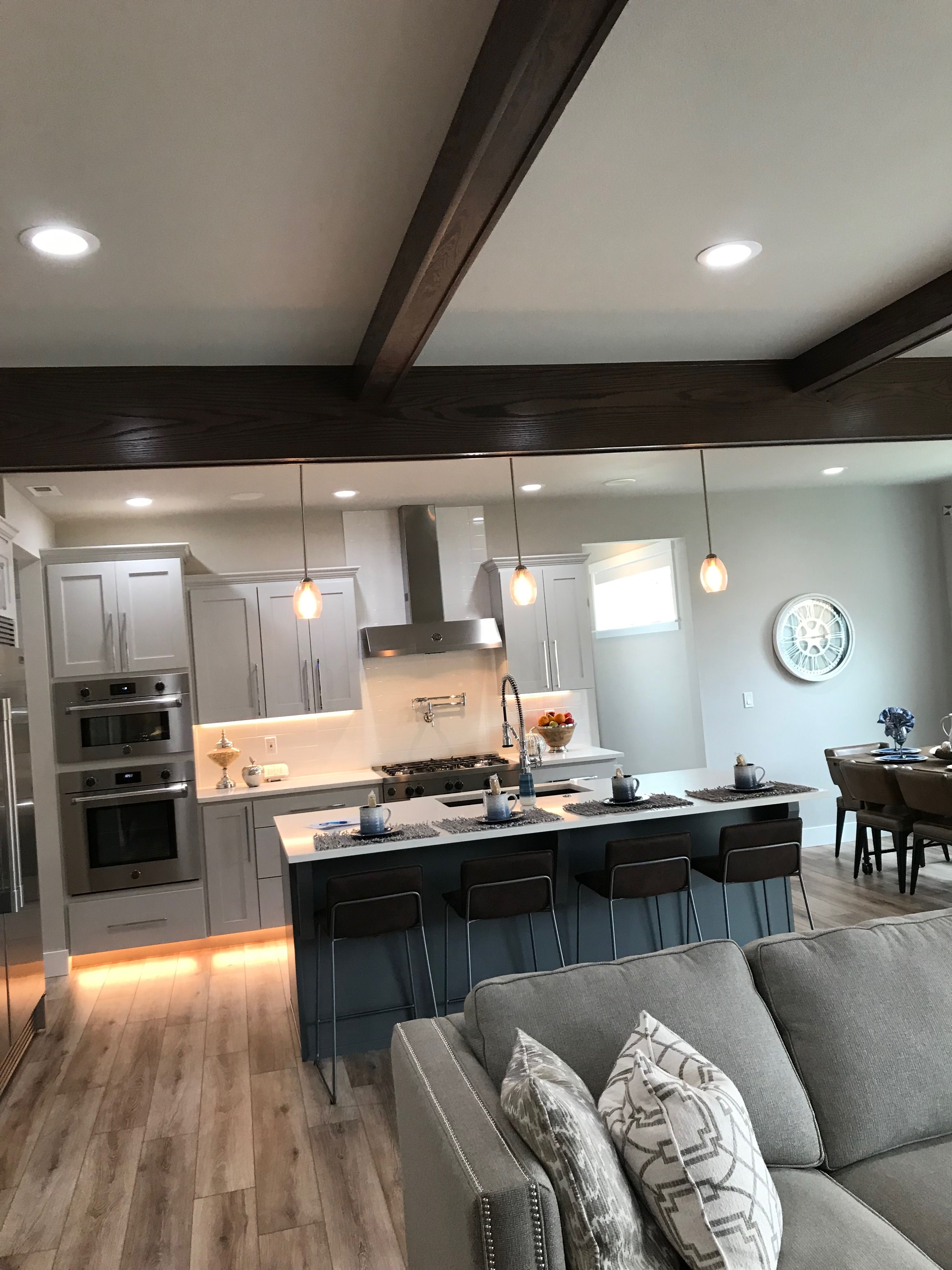 Light gray cabinets with lighting almost the same footprint as ours