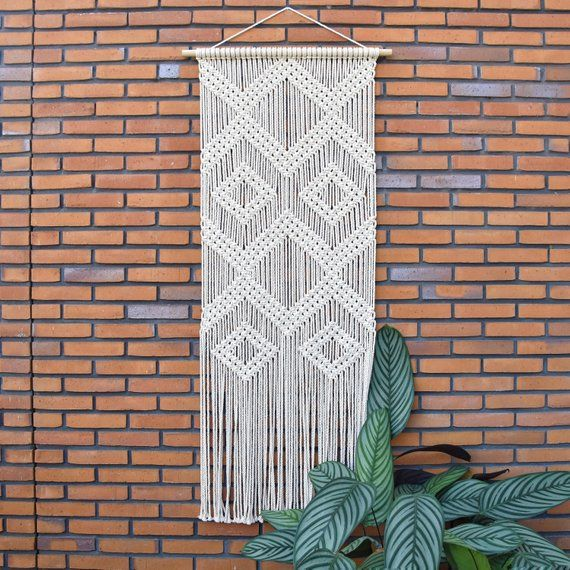 macrame wall hanging large, modern fiber art, wedding backdrop decor, nursery art woven tapestry, boho bedroom decor, macrame art, TOPAZ is part of Boho bedroom Art - DESCRIPTION This beautiful macrame wall hanging is handmade with all natural materials   It features a modern geometric design which will fit perfectely on that empty wall! ●DIMENSIONS The dimensions of this wall hanging are ~dowel length 70 cm ~macrame width 58 cm ~macrame height 160 cm (without suspension cord) ●MATERIALS ~High quality natural cotton cord ~Wooden dowel ●SHIPPING This wall hanging can be shipped worldwide  The shipping time will be around 210 workingdays, depending on the destination  > looking for other measurements or design  Let me know! I would love to create something special for you   To get the latest updates about TamarThings follow me on instagram! @tamarthings