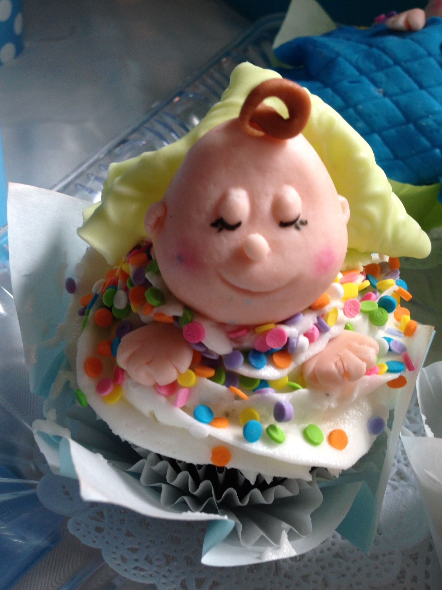 Baby themed cupcakes made of vanilla cake covered with