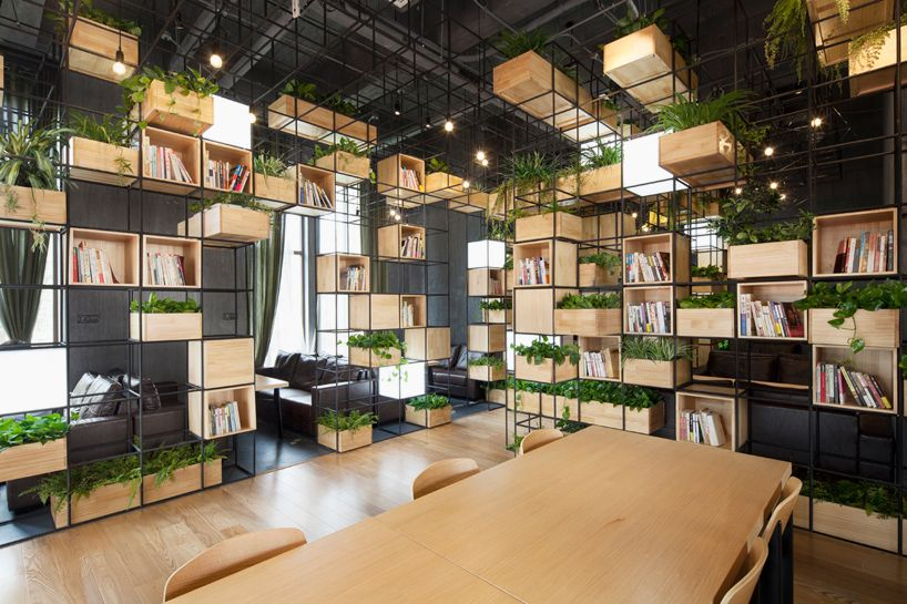 In Beijing China Architecture And Design Studio Penda Has Completed The Interior Of A Local Caf Using Recycled Steel Bars To Serve As Modular Dividers