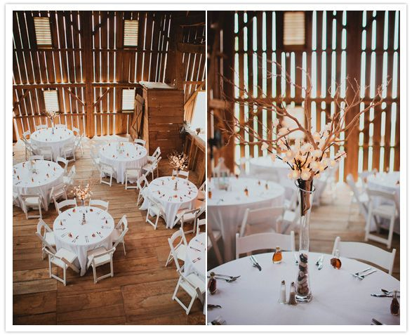 Round Tables With Simple White Linens And Tall Centerpieces Create A Bright  Simplicity In A Barn