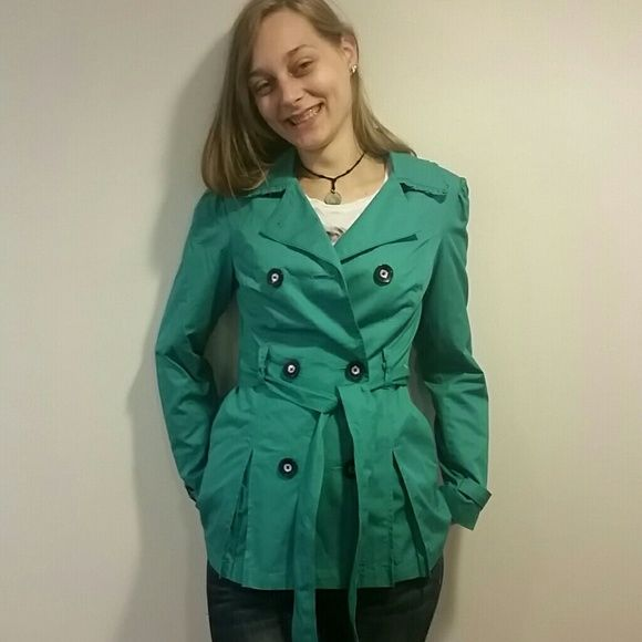 Short teal trench coat It's kind of trench coat but it's super cute. The bow on the back is my favorite detail. The ruffles around the collar and on the back make it look so innocent.(free gift with purchase) Candie's Jackets & Coats Trench Coats