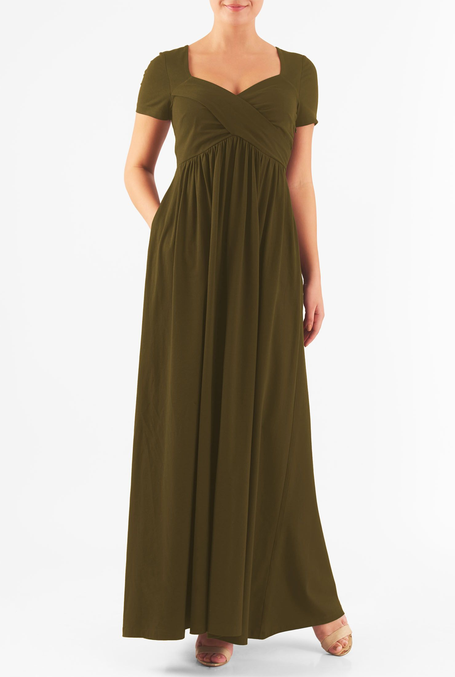 579a60cf1002 A cross-over bodice and ruched pleats accentuate the angled empire waist of  our maxi dress cut from a stretchy jersey knit in a fit-and-flare  silhouette.
