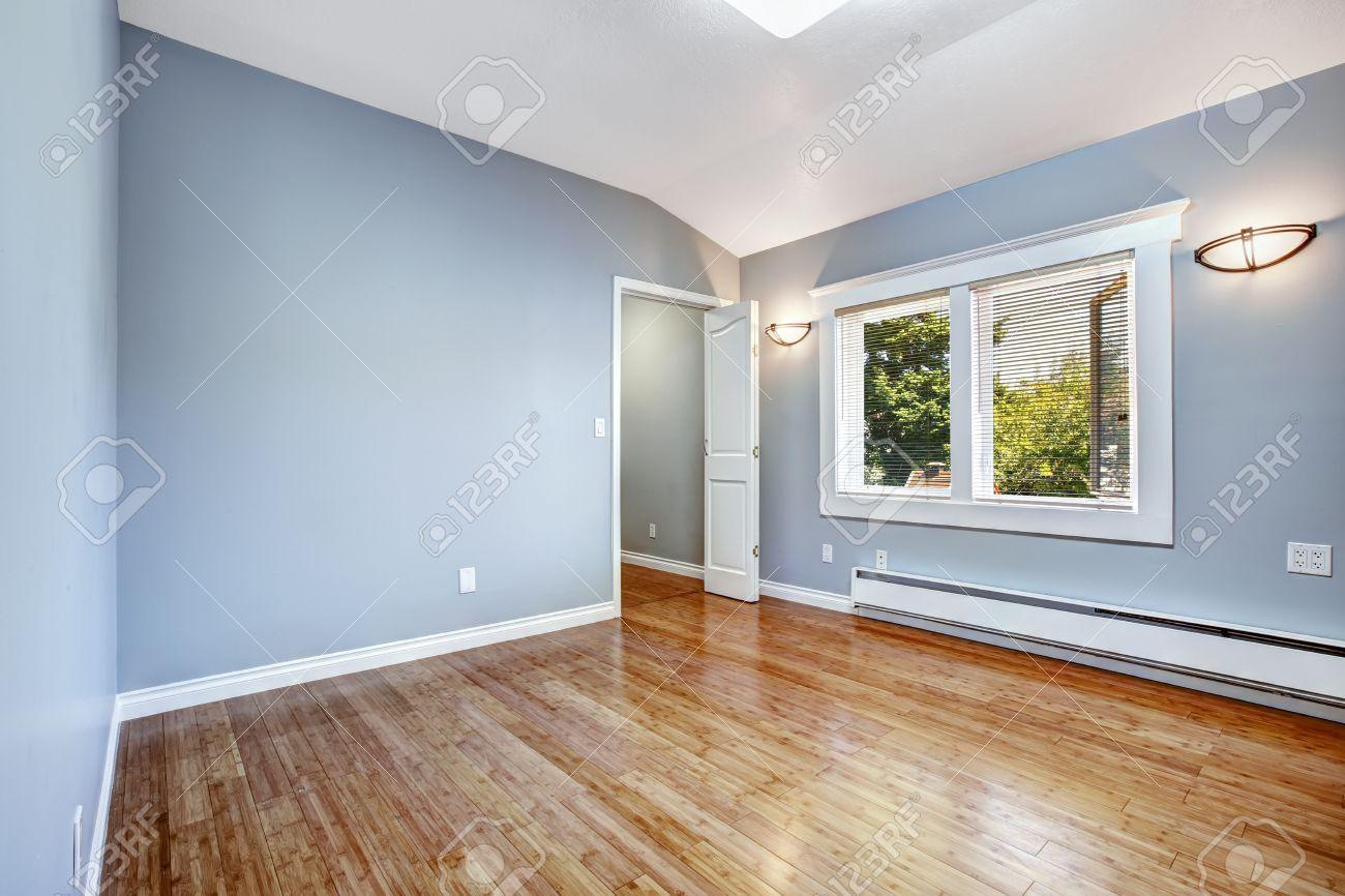 Empty Bedroom With Light Blue Walls And New Hardwood Floor Stock Regarding Hardwood Flooring On Walls Light Blue Walls Light Hardwood Floors Wooden Wall Design
