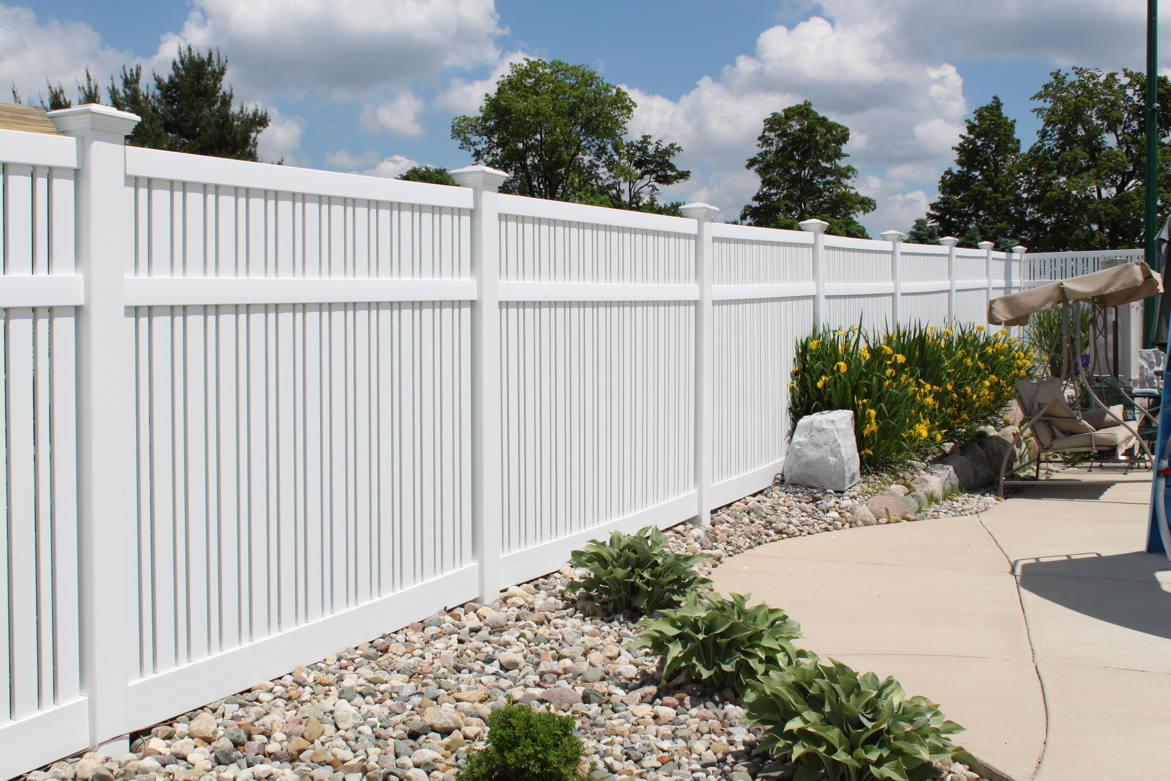 Yard & Pool Fencing Vinyl fencing for securing pools and