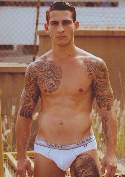 Inked up guy in briefs