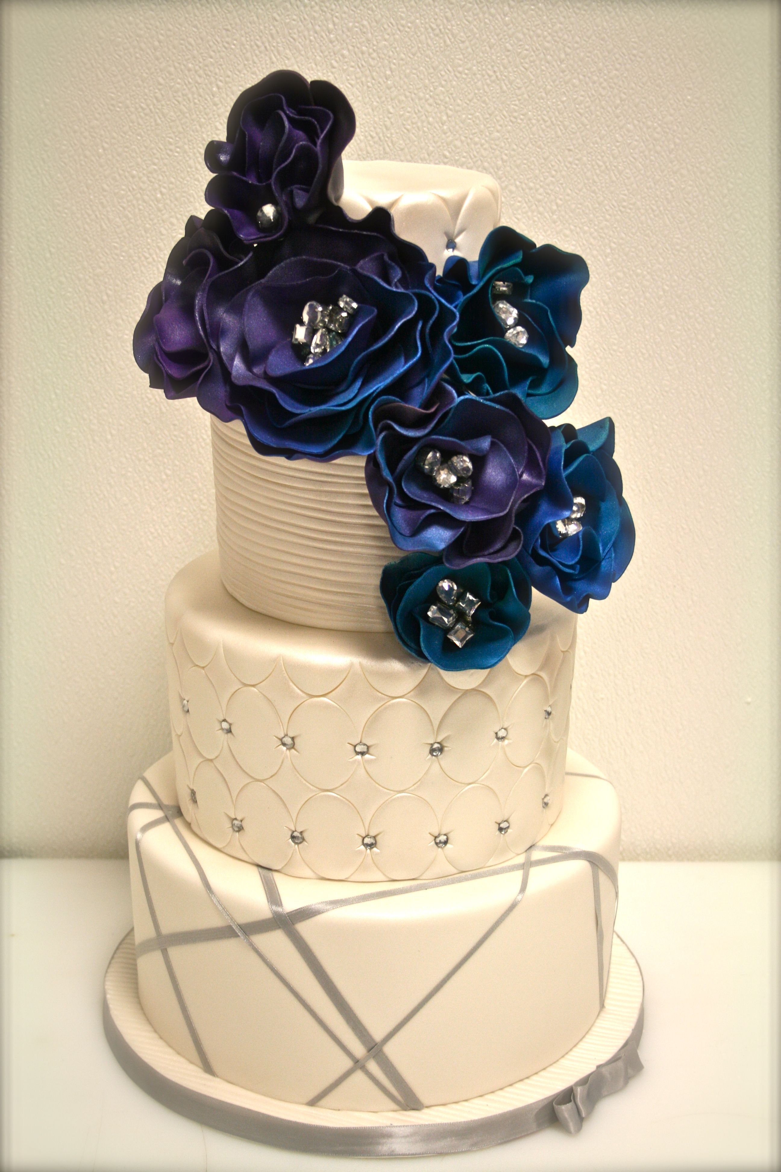 White Wedding Cake with hints of bling and big POP of blue