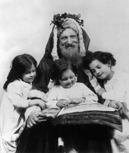 Father Christmas and children, 1915 photo