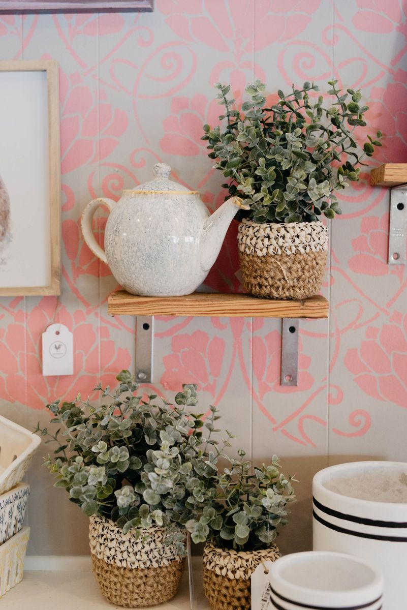 Cute pink lotus stenciled gift store wall! #giftstore #boutique #eucalyptus