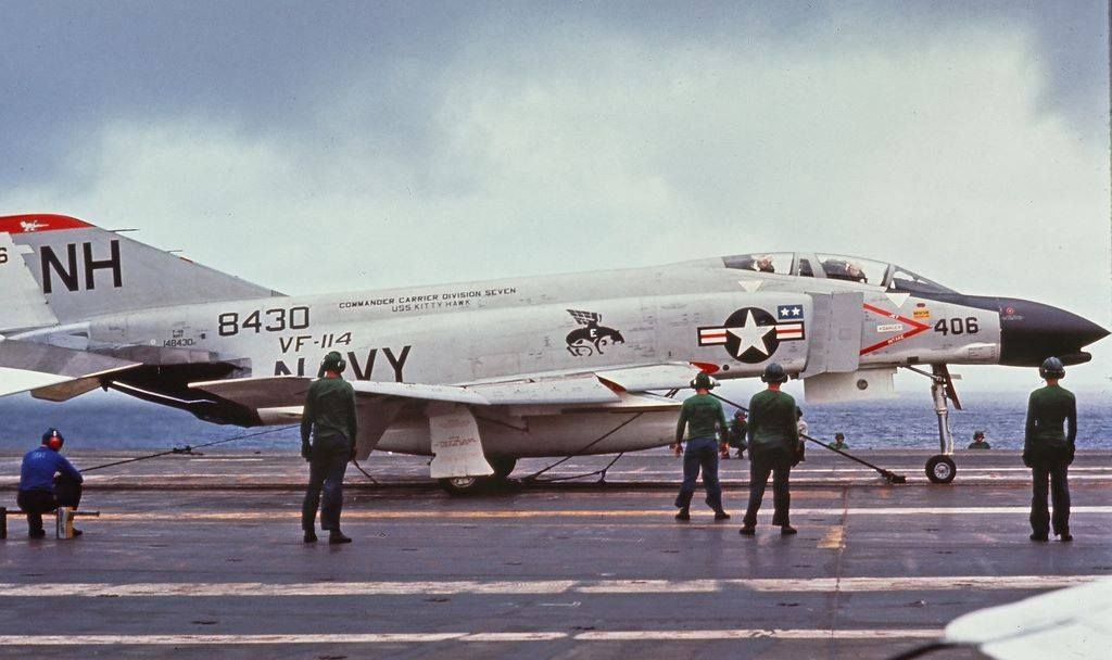 "F-4B from VF-114 ""Aardvarks"". USS Kitty Hawk. Notice the launch bridles  behind the front landing gear 