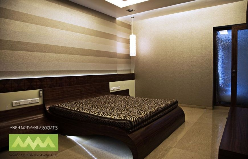 Master Bedroom with wallpaper design by Anish Motwani Associates