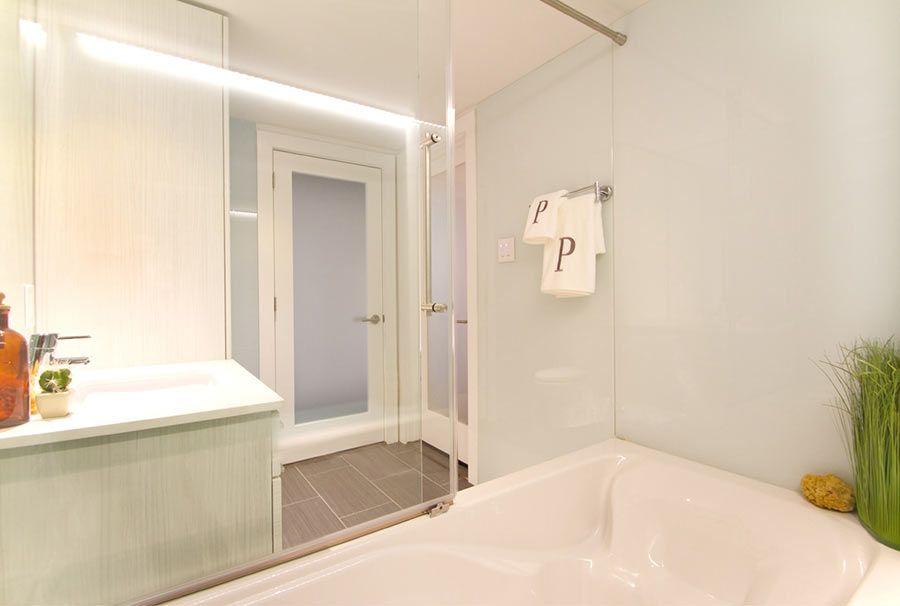 Glacier colored bathtub and bathroom walls panels create a calming ...