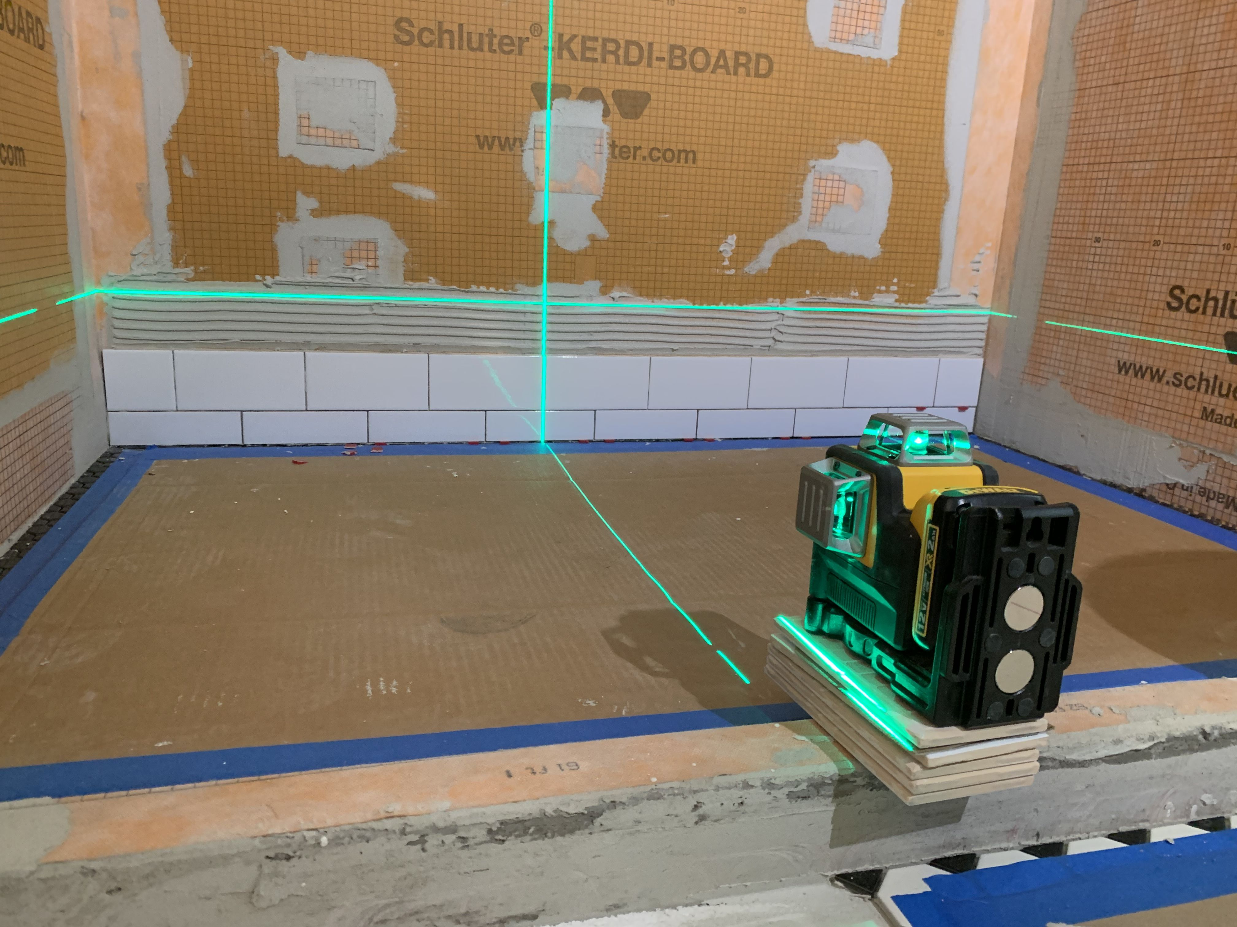 Get Crisp Clean Lines For Tile Framing Cabinet Hanging And Construction Projects With This Dewalt Laser Level Thi Laser Levels Tile Layout Tile Installation