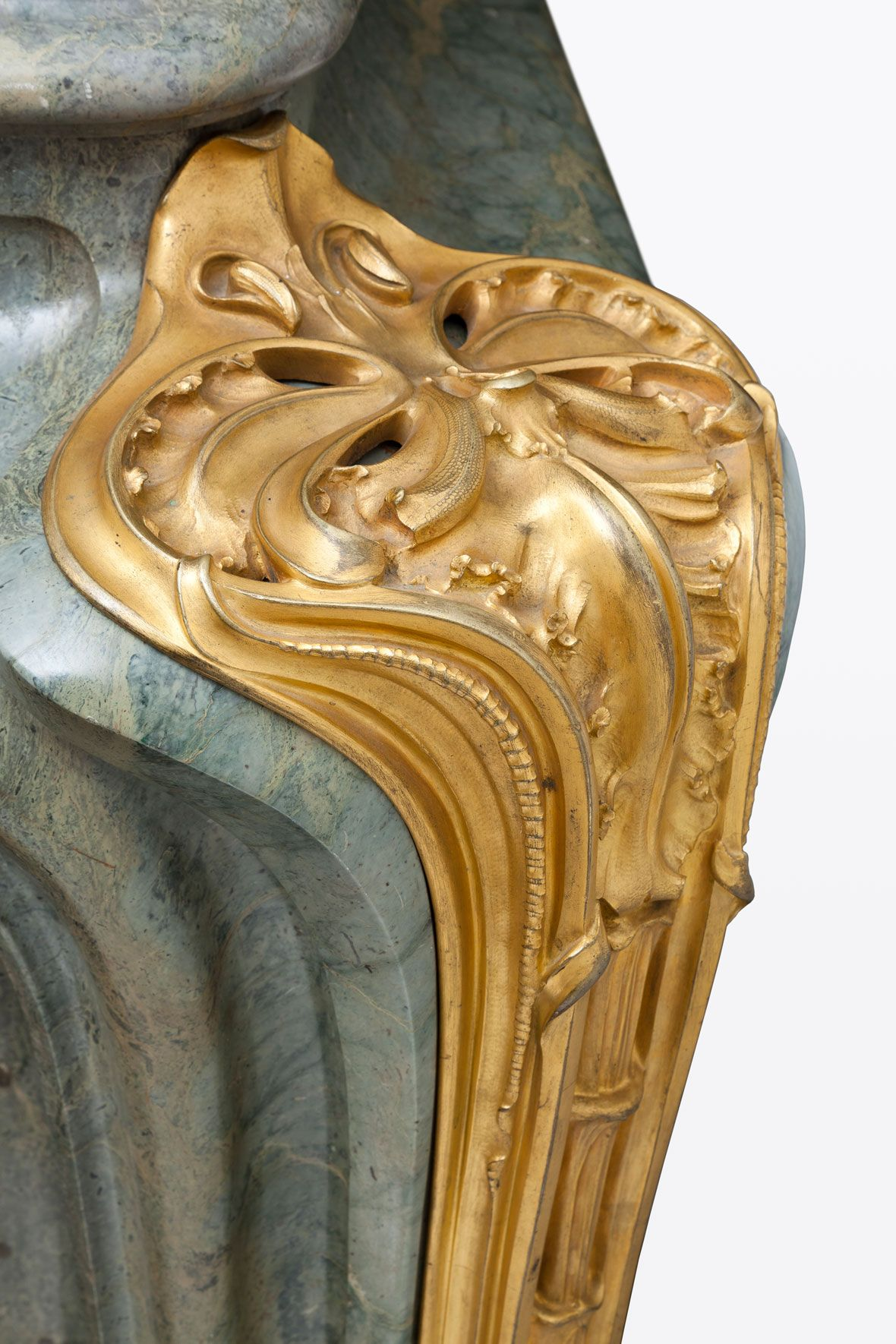Aux Orchidées, An Impressive Campan Vert Vert Marble and Gilt-Bronze-mounted Fireplace By Louis Majorelle, circa 1906 With hammered metal inner surround and gilt metal sliding plate with handle 47 ¾ in (121.3 cm) high, 63 ¾ in (162 cm) wide, 22 in (56 cm) deep Literature Alastair Duncan, Louis Majorelle: Master of Art Nouveau Design, 1991, p.88