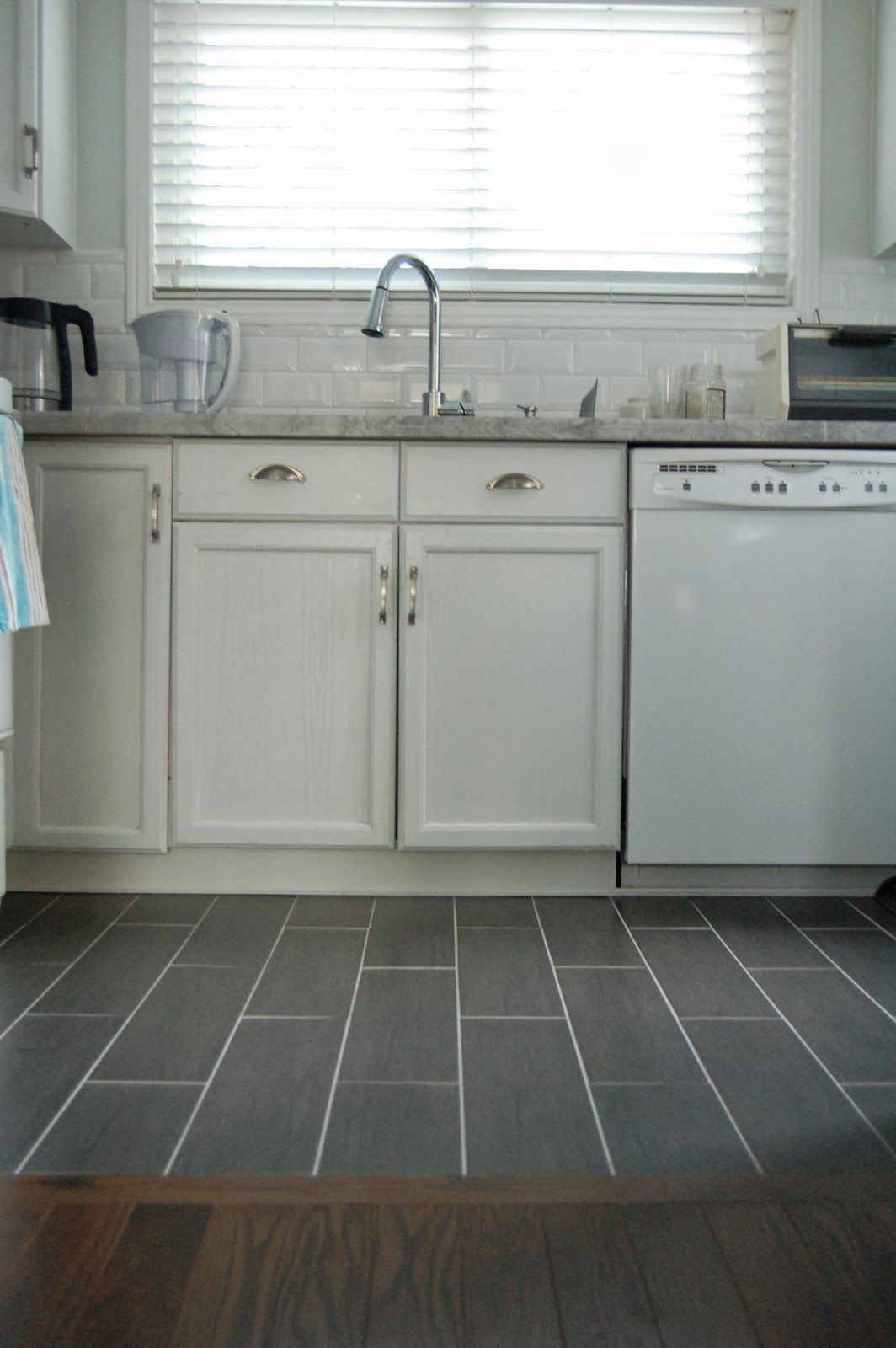 Wood floor to tile transition kitchen remodel for Nice kitchen floor tiles