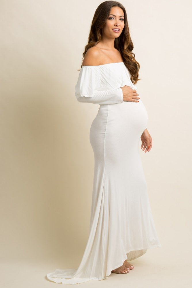 b1873d4571 A solid hued maternity photoshoot gown featuring a cinched elastic off  shoulder neckline with a ruffle trim, long sleeves, a hi-low hemline and a  maxi ...