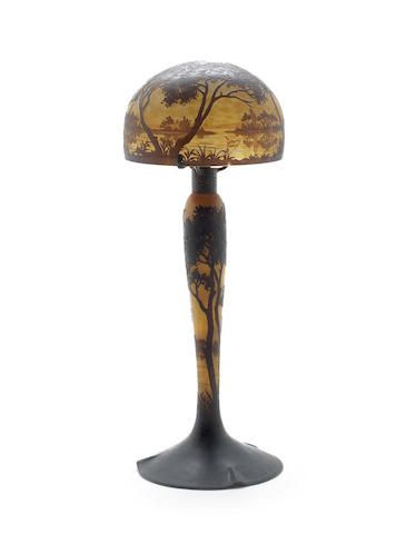 a Daum acid-etched and internally decorated table lamp  SIGNED 'DAUM NANCY'; CIRCA 1925