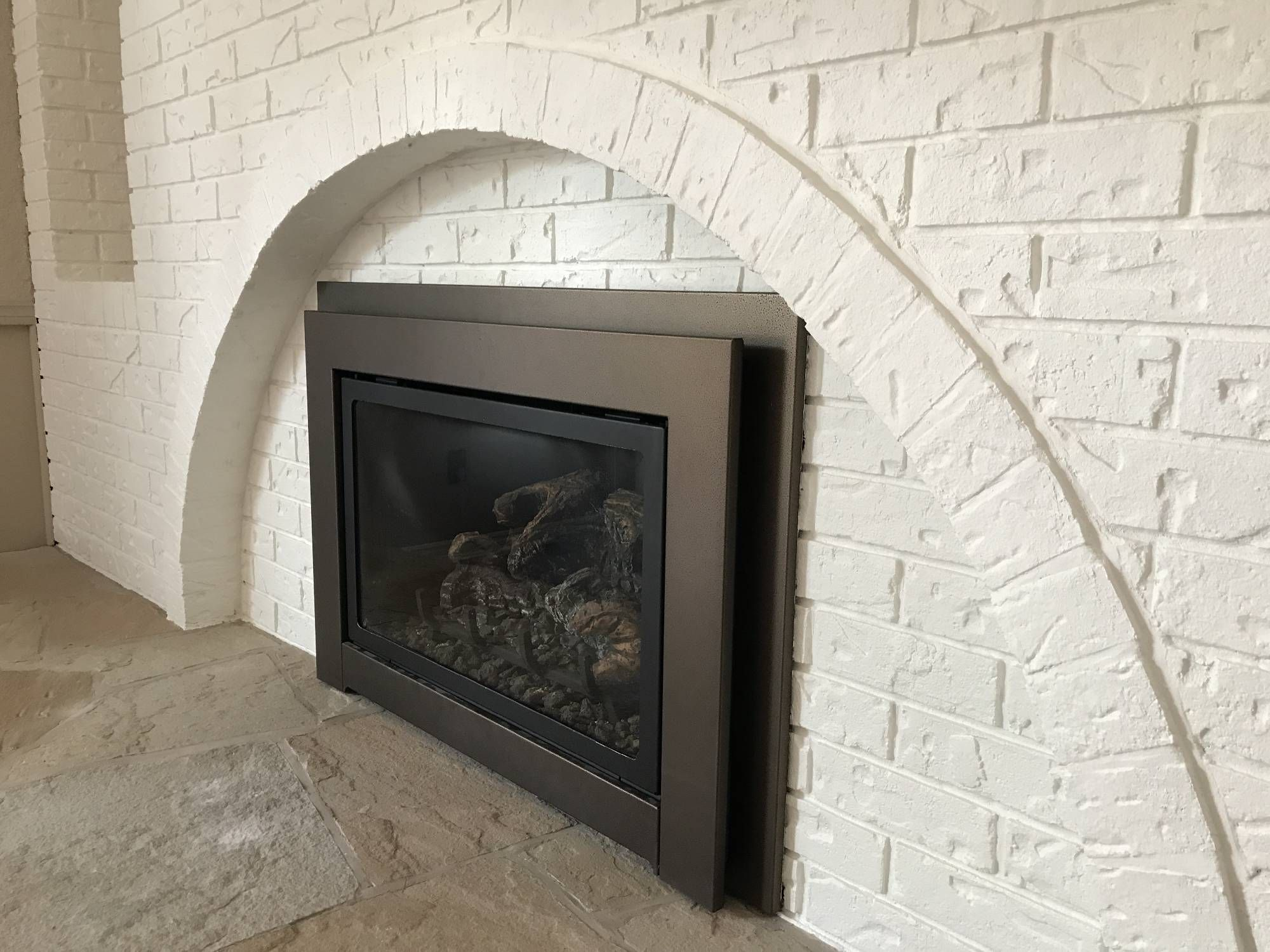 "Brick fireplace rolled not sprayed in Sherwin Williams Loxon-XP in Benjamin Moore ""Simply White"""