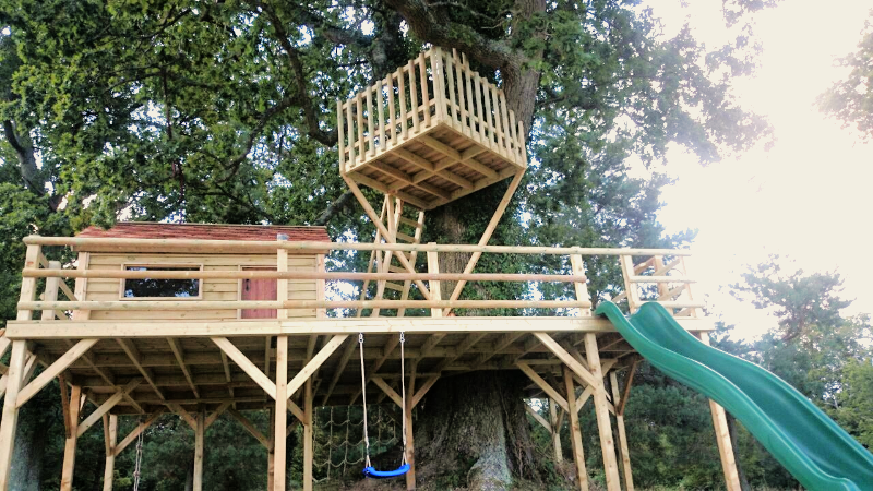 The Miniature Manors double decker garden play area complete with slide and viewing balcony amongst the trees. A unique play area design if you have a sturdy tree.