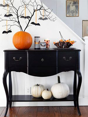 A side table filled with treats and decor!