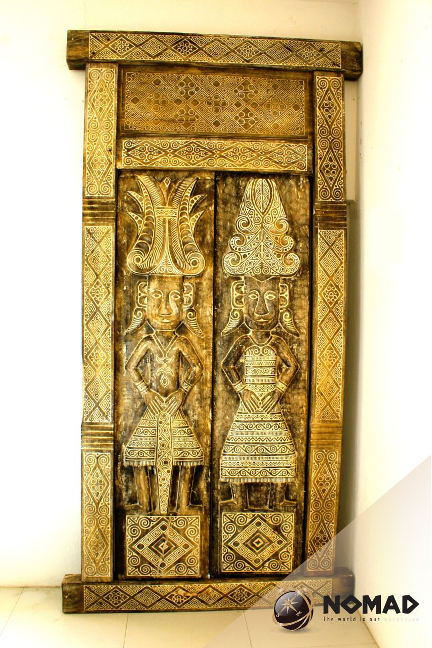 Great carved wooden doors from a company called nomad in mexico